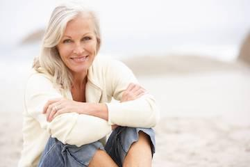 older woman with silver hair smiling l dentist 33809