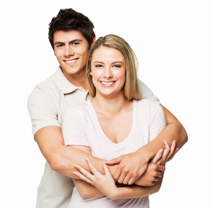 Young couple hugging & smiling l Periodontal treatment lakeland fl